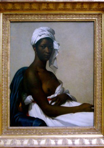 Marie-Guillemine BENOIST. Paris, 1768 - Paris, 1826. Portrait d'une femme noire. Salon de 1800 (Portrait d'une négresse). Ce portrait représentait une domestique ramenée des îles par le beau-frère de l'artiste. l'attitude du modèle, le fond discret, la sobriété efficace du graphisme du coloris renvoient à la leçon de David, qui fut le maître de Madame Benoîst.